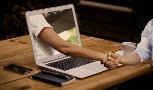 ordenador - apretón de manos - crédito
