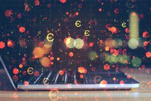 Economia digital - ordenador y simbolos de euro volando en aire