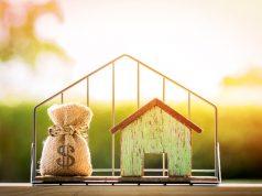 impuesteos - casa con hipoteca y bolso de dolares